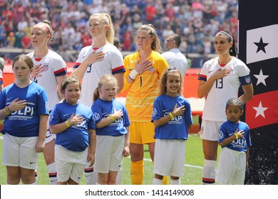 HARRISON, NJ - MAY 26, 2019: U.S. Women's National Soccer Team captain Alex Morgan #13 during National Anthem before friendly game against Mexico as preparation for 2019 Women's World Cup in Harrison