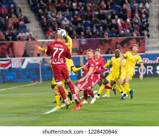 Harrison, NJ - Nov 11, 2018: Daniel Royer (77) of Red Bulls & Artur (8) of Columbus Crew SC fight for ball during 2nd leg MLS Cup Eastern Conference semifinal game at Red Bul Arena Red Bulls won 3 - 0