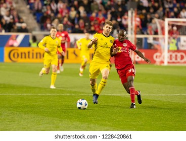 Harrison, NJ - Nov 11, 2018: Bradley Wright_Phillips (99) of Red Bulls & Gaston Sauro (22) of Columbus Crew SC fight for ball during 2nd leg MLS Cup Eastern Conference semifinal game at Red Bull Arena