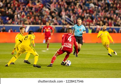 Harrison, NJ - November 11, 2018: Tyler Adams (4) of Red Bulls controls ball during 2nd leg MLS Cup Eastern Conference semifinal game against Columbus Crew SC at Red Bul Arena Red Bulls won 3 - 0