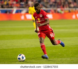 Harrison, NJ - November 11, 2018: Kemar Lawrence (92) of Red Bulls controls ball during 2nd leg MLS Cup Eastern Conference semifinal game against Columbus Crew SC at Red Bul Arena Red Bulls won 3 - 0