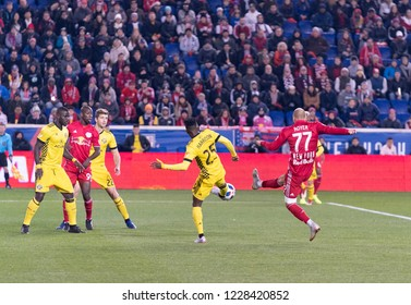 Harrison, NJ - November 11, 2018: Daniel Royer (77) of Red Bulls & Harrison Afful (25) of Columbus Crew SC fight for ball during 2nd leg MLS Cup Eastern Conference semifinal game at Red Bul Arena