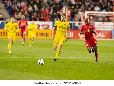 Harrison, NJ - November 11, 2018: Bradley Wright_Phillips (99) of Red Bulls & Gaston Sauro (22) of Columbus Crew SC chase ball during 2nd leg MLS Cup Eastern Conference semifinal game at Red Bul Arena