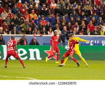 Harrison, NJ - November 11, 2018: Tyler Adams (4) of Red Bulls & Wil Trapp (6) of Columbus Crew SC fight for ball during 2nd leg MLS Cup Eastern Conference semifinal game at Red Bull Arena