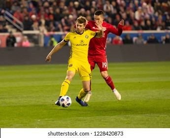 Harrison, NJ - November 11, 2018: Alex Muyl (19) of Red Bulls & Gaston Sauro (22) of Columbus Crew SC fight for ball during 2nd leg MLS Cup Eastern Conference semifinal game at Red Bull Arena