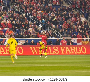 Harrison, NJ - November 11, 2018: Michael Murillo (62) of Red Bulls & Gyasi Zardes (11) of Columbus Crew SC fight for ball during 2nd leg MLS Cup Eastern Conference semifinal game at Red Bull Arena