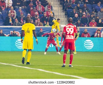 Harrison, NJ - November 11, 2018: Alex Nuyl (19) of Red Bulls & Wil Trapp (6) of Columbus Crew SC fight for ball during 2nd leg MLS Cup Eastern Conference semifinal game at Red Bull Arena