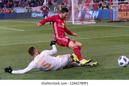 Harrison, NJ - November 29, 2018: Leandro Gonzalez Pirez (5) of Atlanta United & Andreas Ivan (9) of Red Bulls fight for ball during 2nd leg MLS Cup Eastern Conference final at Red Bull Arena