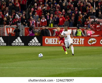Harrison, NJ - November 29, 2018: Darlington Nagbe (6) of Atlanta United & Daniel Royer (77) of Red Bulls fight for ball during 2nd leg MLS Cup Eastern Conference final at Red Bull Arena