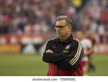Harrison, NJ - October 15, 2017: Atlanta United FC coach Gerardo Martino reacts during regular MLS game against New York Red Bulls on Red Bull Arena