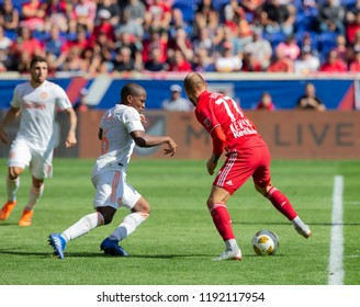Harrison, NJ - September 30, 2018: Daniel Royer (77) of Red Bulls & Darlington Nagbe (6) of Atlanta United FC fight for ball during regular MLS game at Red Bull Arena Red Bulls won 2 - 0