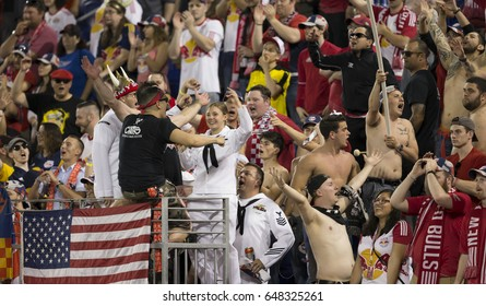 Harrison, NJ USA - Amy 27, 2016: Fans including US Navy sailors celebrate during MLS game between New York Red Bulls & New England Revolution on Red Bull Arena, Red Bulls won 2 - 1