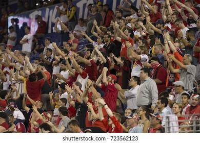 Harrison, NJ USA - September 27, 2017: Red Bulls fans support their team during regular MLS game against DC United at Red Bull Arena