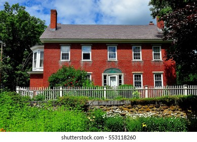 Harrisville, New Hampshire - July 12, 2013:  Early 19th century brick home with picket fence and gardens in the historic district