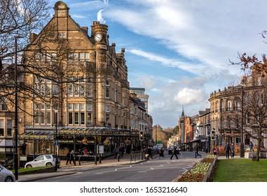 Harrogate, England - February 2020: Harrogate main street with famous Betty's Tea Rooms, North Yorkshire,England, United Kingdom