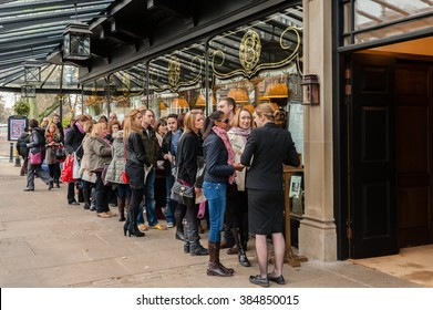 HARROGATE, UK - NOVEMBER 17, 2012: People waiting to enter the famous Bettys Tearoom in Harrogate, North Yorkshire, UK