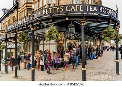 HARROGATE, UK - NOVEMBER 17, 2012: People waiting to enter the famous Bettys Tearoom in Harrogate, North Yorkshire, UK