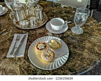 HARROGATE, UK - NOVEMBER 18, 2018: Tea and minced pies and brandy butter at the famous Betty's Tearoom. Harrogate is a spa town in North Yorkshire, England.