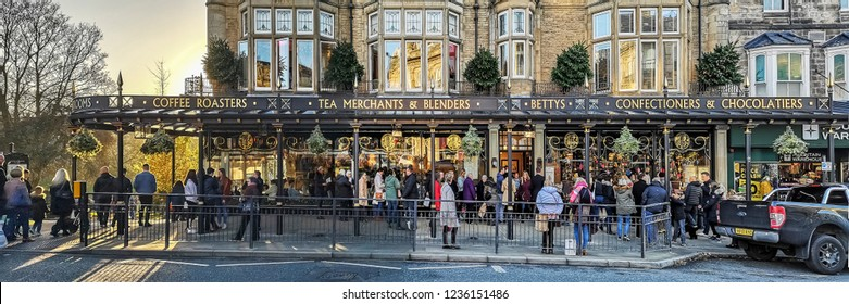 HARROGATE, UK - NOVEMBER 18, 2018: People queing to enter the famous Betty's Tearoom. Harrogate is a spa town in North Yorkshire, England.