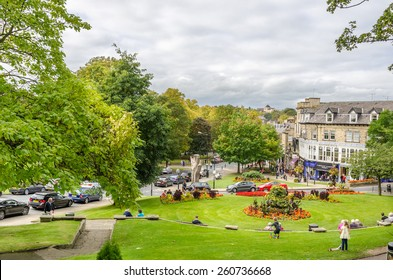 Harrogate, UK - September 27, 2014: People enjoying a Warm Autumn Day in a Garden in the Town Centre. Harrogate is consistently voted as one of the best places to live in the UK.