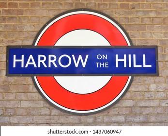Harrow, London, England, UK - June 28th 2019: Harrow on the Hill station London Underground Metropolitan railway roundel sign