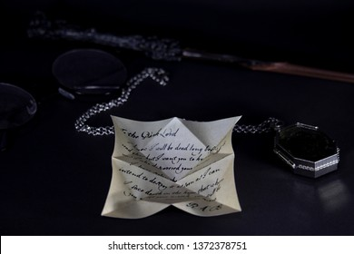 Harry Potter items; wand and glasses of Harry Potter, Slytherin's Locket, letter of Regulus Arcturus Black on the black background.  ISTANBUL / TURKEY - APRIL 15, 2019