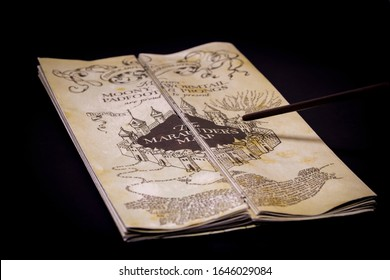 Harry Potter's wand and Marauder's Map on the black background. ISTANBUL / TURKEY - FEBRUARY 9, 2020