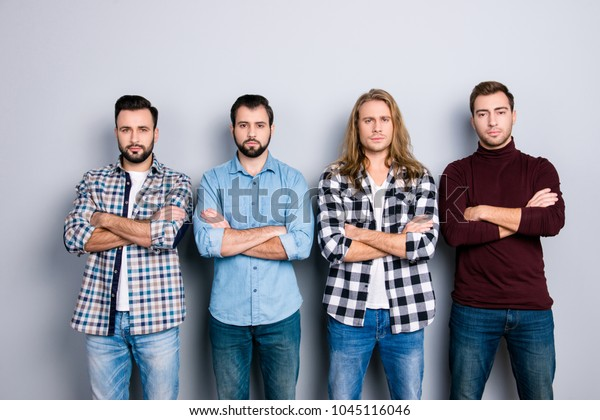 Harsh concentrated angry self-assured brutal macho strength success concept. Portrait of four calm peace man wearing checkered shirt turtleneck standing with crossed arms isolated on gray background