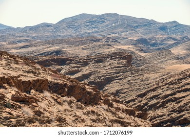 harsh rocky landscape by sunny day in Namibia