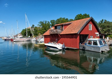 HARSTENA, SWEDEN - JULY 22: Leisure boats moored at Harstena Island on July 22, 2009 in the Baltic Sea. Harstena belongs to the archipelago of Gryt and is a popular destination for leisure boats.