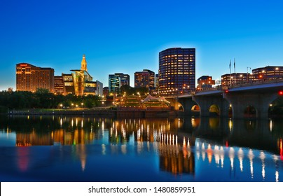 Hartford Connecticut - July 21, 2019:  The beautiful sunset over Connecticut River at Hartford Connecticut. Photo shows the skyline of Hartford and Founders Bridge after sunset.