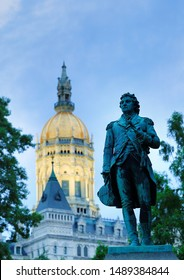 Hartford Connecticut - July 22, 2019: A Statute of Israel Putnam, an officer in the American Revolution. stands at the Connecticut State Capitol in Hartford, Connecticut after sunset.