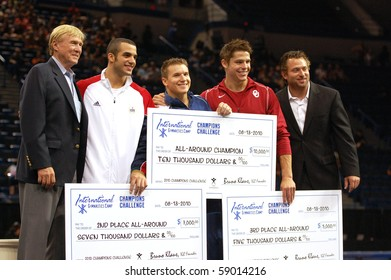 HARTFORD; CT - AUGUST 13: Top All-Around gymnasts Jonathan Horton, Danell Leyva & Chris Brooks display their cash prize awards at the VISA Gymnastics Championships on August 13, 2010 in Hartford; CT