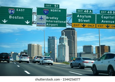 Hartford, CT USA. Sep 16 2019. Interstate 91 and 84, and Bradley International Airport highway signs within the city of Hartford.