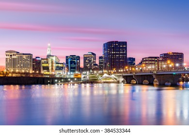Hartford skyline and Founders Bridge under a purple twilight. Hartford is the capital of Connecticut.