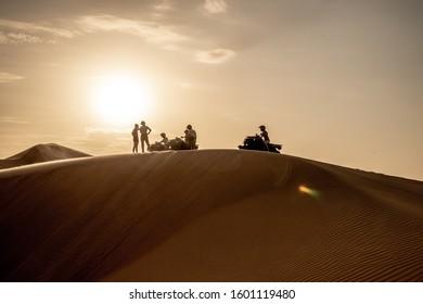 HARTMANN'S VALLEY, NAMIBIA: NOVEMBER 7, 2019 - Enjoying the beautiful desert landscape at sunset - Hartmann Valley, Namibia