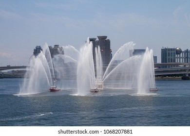 HARUMI, TOKYO, JAPAN - MAY 28, 2017. Different kinds of Fireboats from the Tokyo Fire Department spray their water canon during a display for the public in Tokyo Bay.