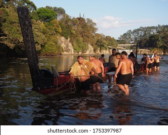 Haruru Falls, New Zealand - 06. February 2019: Preparing of the traditional Maori Waka (canoes) in the early morning of Waitangi Day - public holiday to celebrate the signing of the Treaty of Waitangi