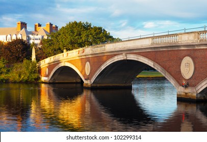 Harvard University bridge over the Charles River between Cambridge and Boston with beautiful reflections on the water below.  Copy space.