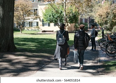 HARVARD UNIVERSITY, HARVARD, MA, USA - CIRCA OCTOBER 2016: Harvard students seen walking to there classes within the central campus.