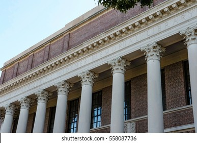 HARVARD UNIVERSITY, HARVARD, USA - CIRCA OCTOBER 2016: Detailed view of the main Harvard University library entrance showing the detailed architecture and in view some Harvard students.