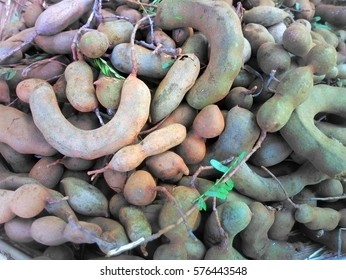 Harvest in Asia. Peanut in Shell arachis, earth-nut, monkey nut scattered evenly, bazaar. Background