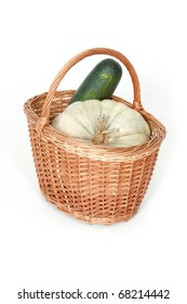 Harvest basket with pumpkin and vegetable marrow