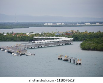 HARVEST CAYE, BELIZE—JANUARY 2018: Aerial shot of the shaded walkway for passengers and the cruise ship port of Harvest Caye in Southern Belize.