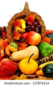 Harvest cornucopia filled with assorted vegetables and fruit