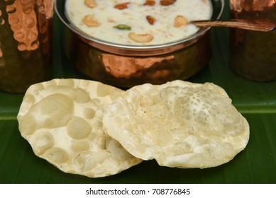 Harvest festival Onam sweet dessert food made of rice, milk, cashew nut and rasin on banana leaf Kerala India.
