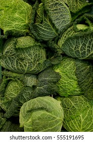 harvest, food, vegetables and agriculture concept - close up of savoy cabbages