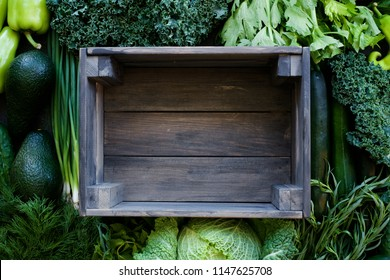 Harvest of fresh organic green vegetables. Top view, food background. Healthy lifestyle