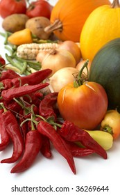 Harvest. Fresh ripe vegetables with cayenne in center