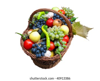 Harvest fruits and vegetables in a wooden box isolated over white background